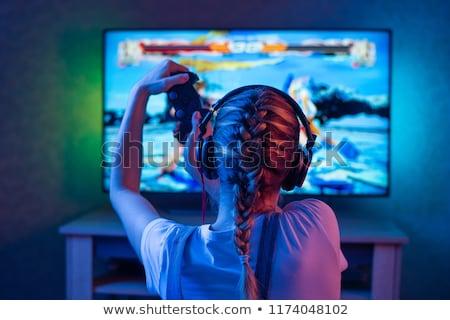 excitado · nina · videojuegos · la · boca · abierta · mano - foto stock © photography33