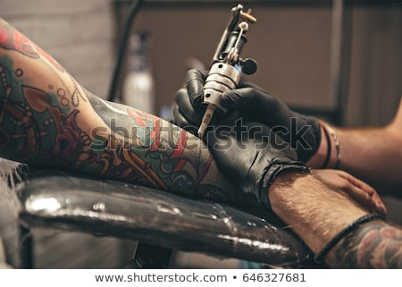 Tatouage artiste femme gants Photo stock © imarin