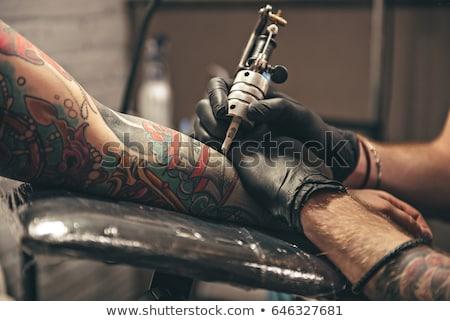 férfi · nő · kaukázusi · férfi · tetoválás · művész - stock fotó © imarin