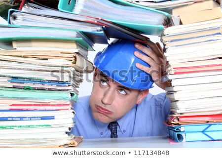 Architect surrounded by piles of paperwork Stock photo © photography33