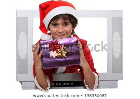 Little boy dressed as Santa escaping from television set Stock photo © photography33