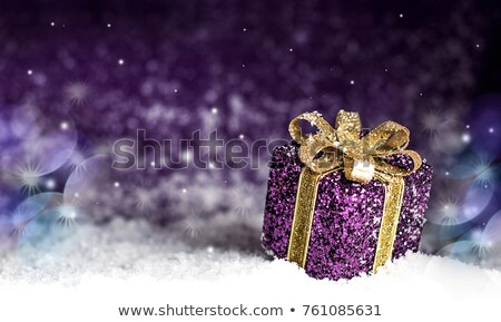 Photo stock: Purple Christmas Present In Snow