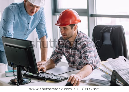young man in a hardhat with a laptop stock photo © photography33