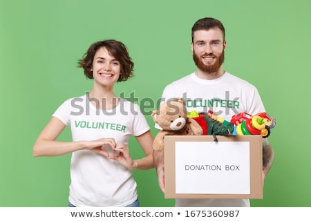 portrait of boy holding hearts shape in container stock photo © zzve