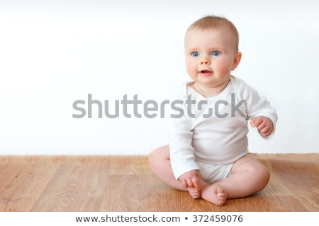 baby sitting and smile stock photo © get4net