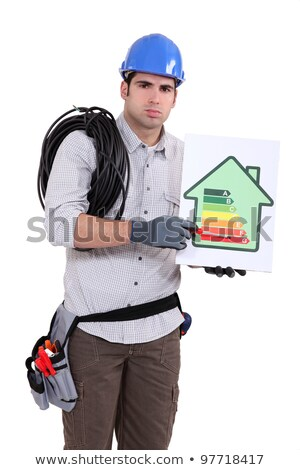 Tradesman pointing to an energy efficiency rating chart Stock photo © photography33
