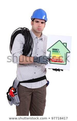 Senalando la eficiencia energética tabla casa hombre Foto stock © photography33
