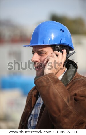 Builder speaking into his walkie-talkie Stock photo © photography33