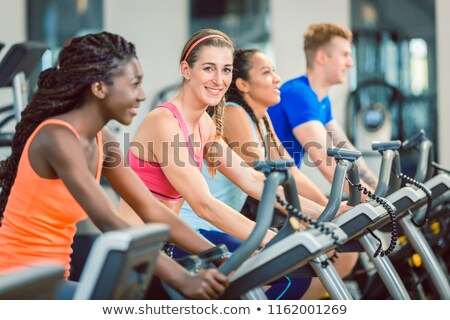 Brunette on cycling in the gym Stock photo © photography33