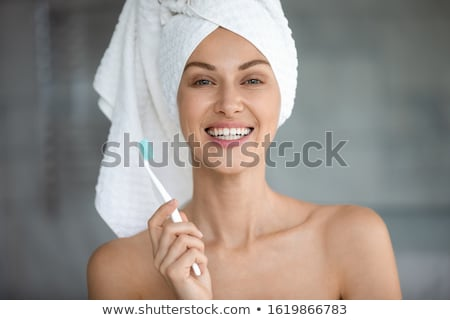 Closeup of beautiful young lady holding toothbrush stock photo © dash