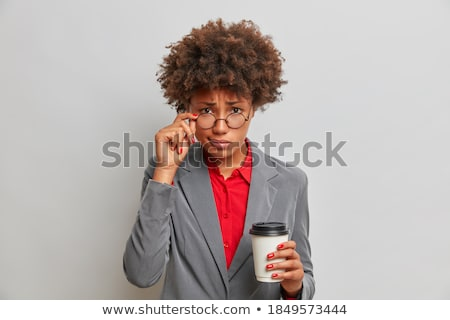 Portrait of a young businesswoman holding a takeaway tea against a white background stock photo © wavebreak_media