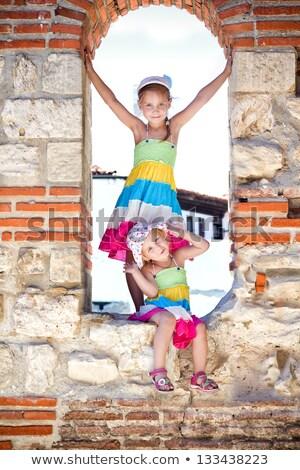 Beautiful Little Girl In Ancient Ruins Of The Nesebar Foto d'archivio © Len44ik