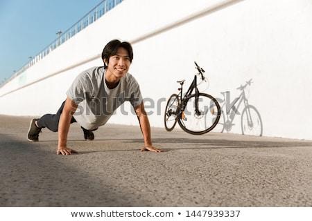 csinos · fiú · bicikli · kívül · délután · út - stock fotó © massonforstock