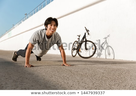 bastante · menino · bicicleta · fora · tarde · estrada - foto stock © massonforstock