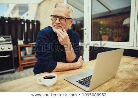 Senior thinking of retirement Stock photo © curvabezier
