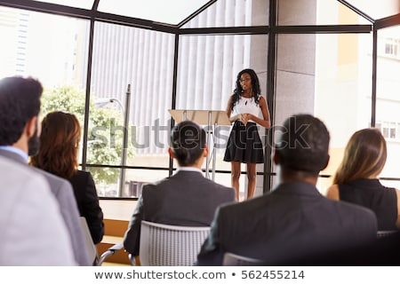 business woman presenting in back Stock photo © feedough