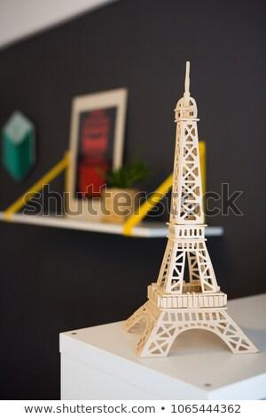 eiffel tower statue on wooden background stock photo © inxti