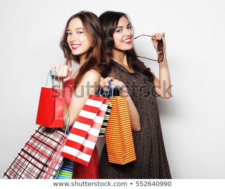 Mooie vrouw glimlachend naar zonnebril mooie jonge Stockfoto © lovleah