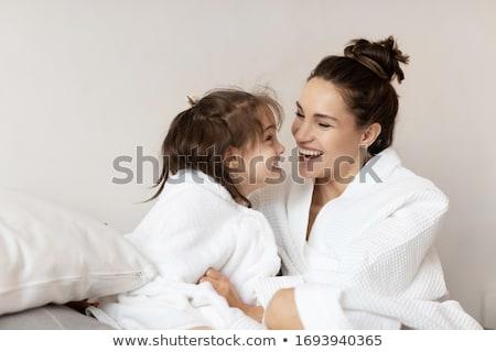 Mujer albornoz mujer hermosa sesión cama Foto stock © chesterf