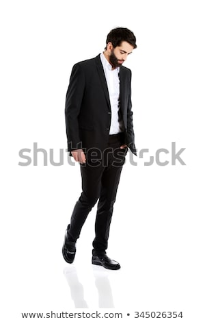 business man looks down pensively stock photo © feedough