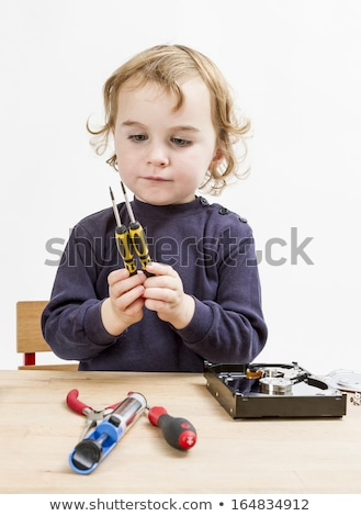 Stock photo: child choosing tool for repairing hard drive
