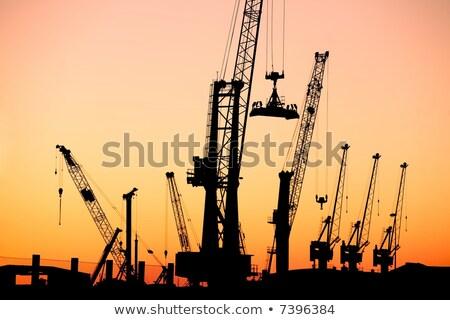 silhuetas · nublado · céu · trabalhar · navio · industrial - foto stock © cozyta