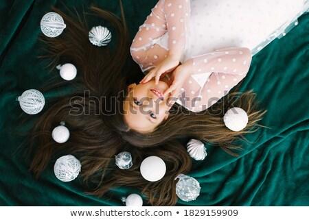 Happy teenage girl dreaming with christmas ball Stock photo © o_p_m