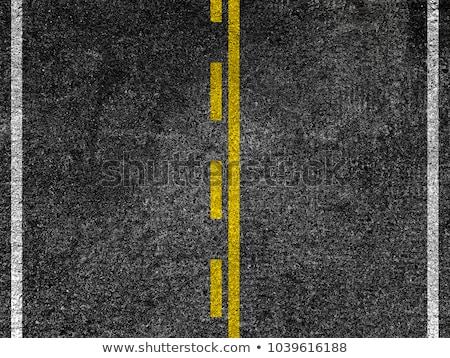 Yellow striped road markings on black asphalt. Stock photo © stevanovicigor