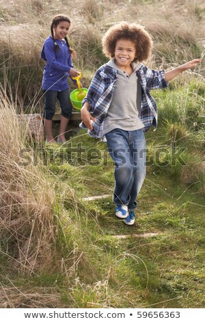 Young Children Carrying Fishing Net At Seaside Stock photo © monkey_business