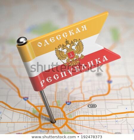 Odessa People's Republic Small Flag on a Map Background. Stock photo © tashatuvango