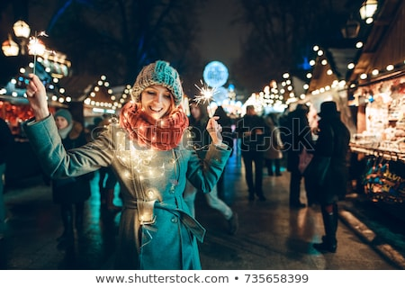 vrouw · winter · straat · licht · sneeuwval · glimlachende · vrouw - stockfoto © nejron