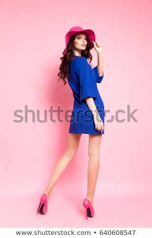 Cute young brunette posing in blue dress Stock photo © dash