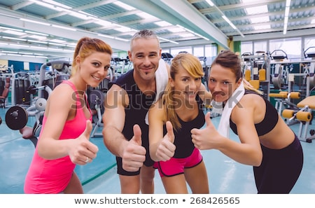 Stock photo: Athletic man and woman after fitness exercise with thumbs up on