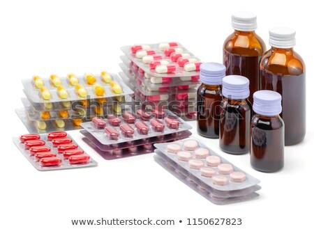 medicine bottle with yellow syrup isolated on white background Stock photo © tetkoren