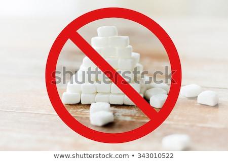 close up of white sugar pyramid on wooden table stock photo © dolgachov