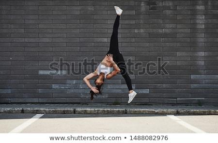 Bela mulher acrobático isolado branco mulher Foto stock © deandrobot