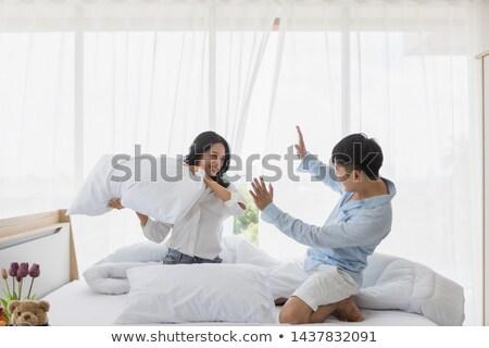 Sevimli çift yastık kavgası ev yatak odası kadın Stok fotoğraf © wavebreak_media