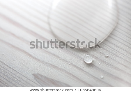 water drops on wooden furniture stock photo © photosebia