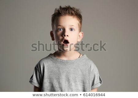 handsome surprised little boy stock photo © svetography
