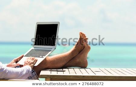 человека рабочих отпуск красивый мужчина сидят лежак Сток-фото © filipw