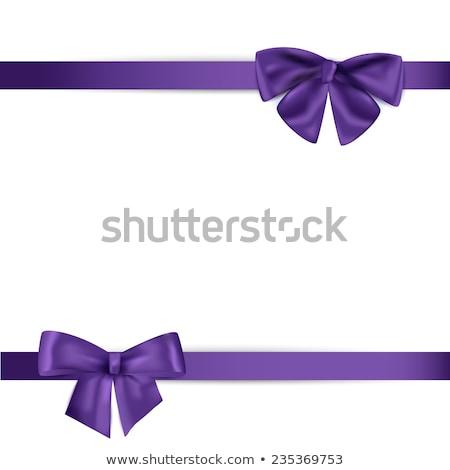 blue ribbon with purple bow on white stock photo © shutswis