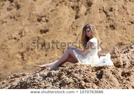 blonde girl in gold bikini posing stock photo © pawelsierakowski