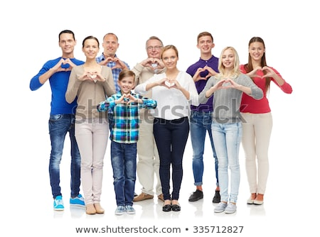 Vidám fiú mutat szív kézjel gyermekkor szeretet Stock fotó © dolgachov