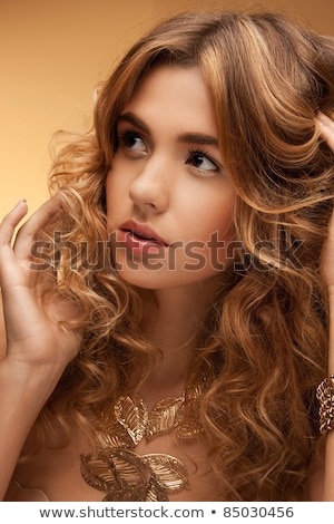 Beauty portrait of charming alluring woman with curly long hair  Stock photo © deandrobot