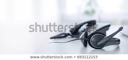 office desk with headset call center stock photo © karandaev