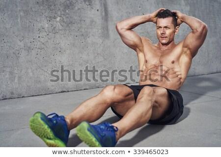 Fort bodybuilder pas shirt blanche sexy Photo stock © wavebreak_media