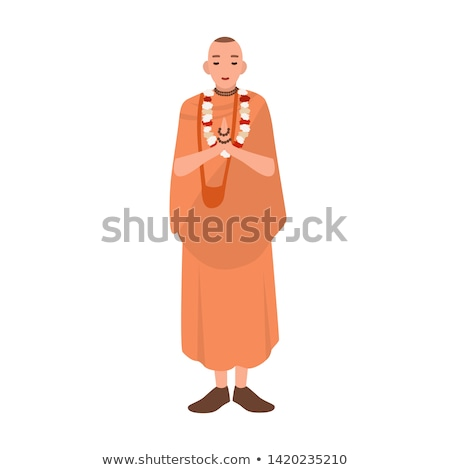 priest standing with eyes closed and praying stock photo © deandrobot