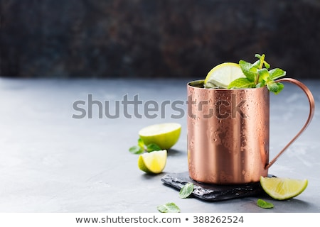 Сток-фото: Cold Moscow Mules Cocktail With Ginger Beer Vodka Lime Grey Stone Background Copy Space