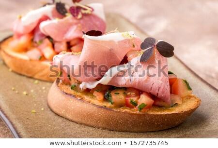 crispy slice of pork meat on bread stock photo © digifoodstock