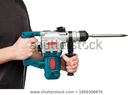 Young Repairman With Drill Perforator Isolated On White Stock fotó © O_Lypa